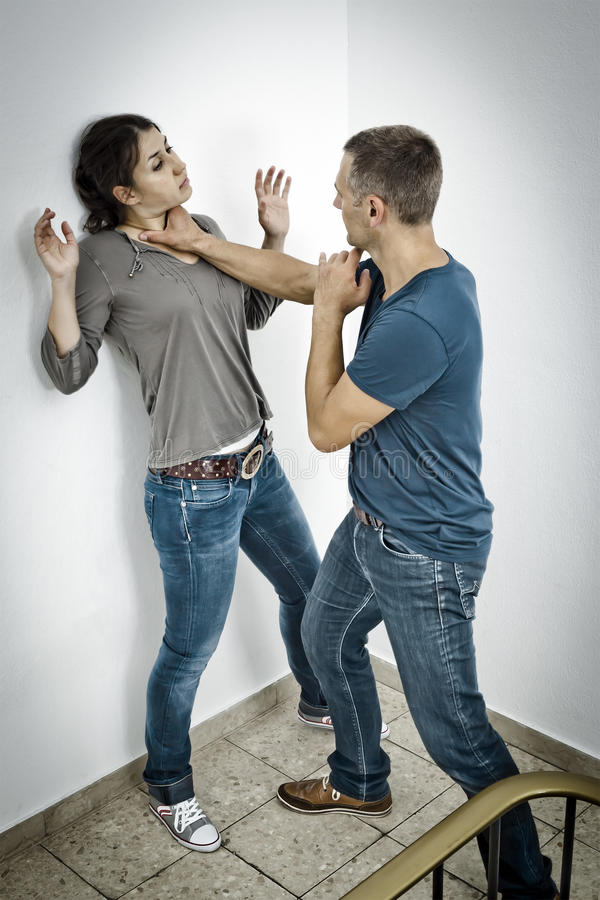 Attacked by a man. A young women is attacked by a man royalty free stock images