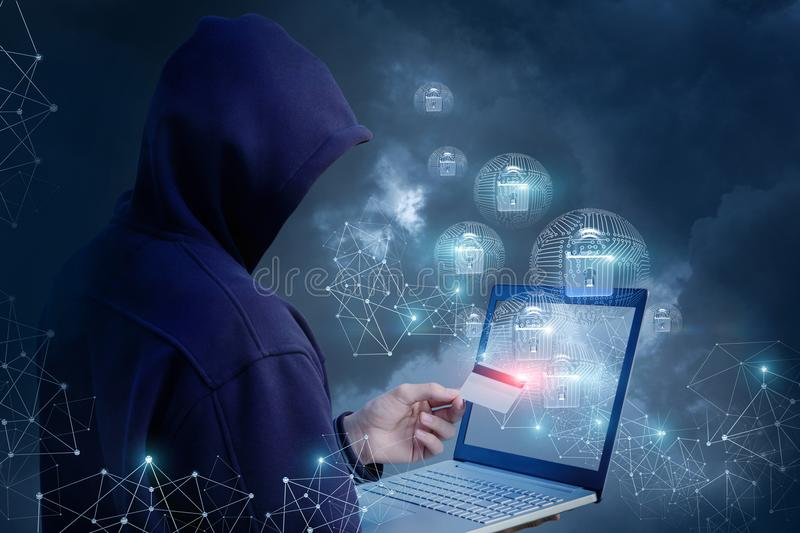 Attacker is trying to open a payment card . stock photography