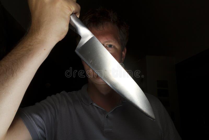 Attaque de couteau photographie stock