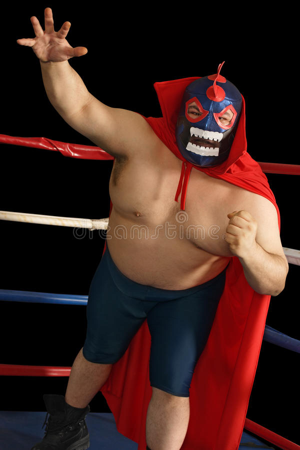 Attaques mexicaines de lutteur photographie stock