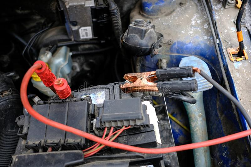 attempt to start the engine of the car with the sown battery using the method of lighting up stock photography