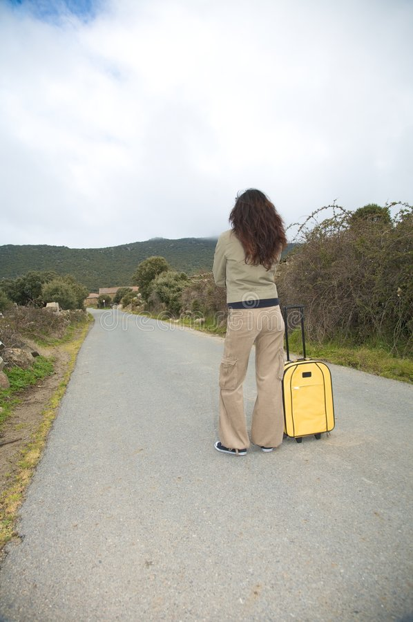 Attendendo con la valigia fotografia stock libera da diritti