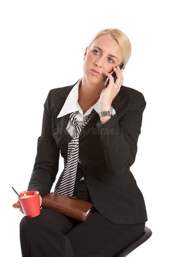 Attendendo sul telefono immagine stock