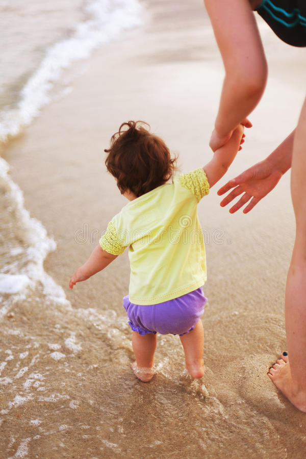 Download Attending Baby On Sea Shore Stock Photo - Image: 32309500