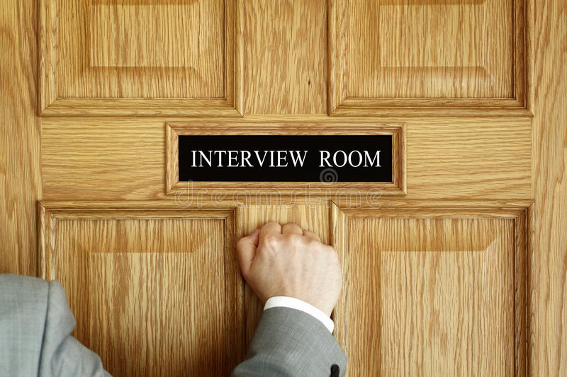 Attending an interview. Businessman knocking on interview room door concept for recruitment or medical checkup with a consultant royalty free stock image