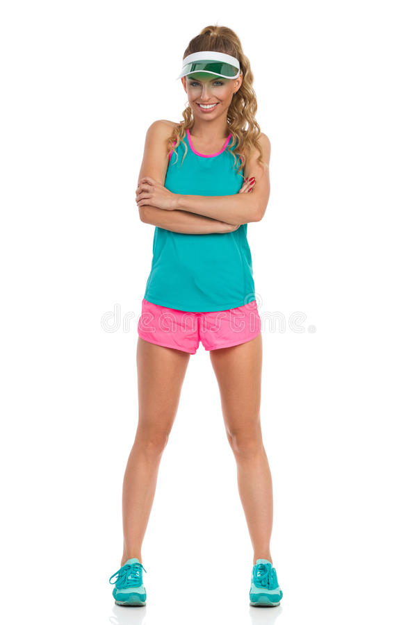 Attente sûre de femme de sport d'isolement photographie stock