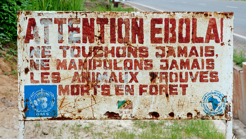 ATTENTION EBOLA. MAKOUA, CONGO, AFRICA - SEPTEMBER 27, 2013: A sign warns visitors that area is a Ebola infected. Signage informing visitors that it is a ebola