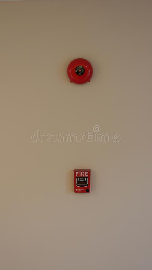 Attention, alert. Fire alarm with bright red bell on the wall. stock image