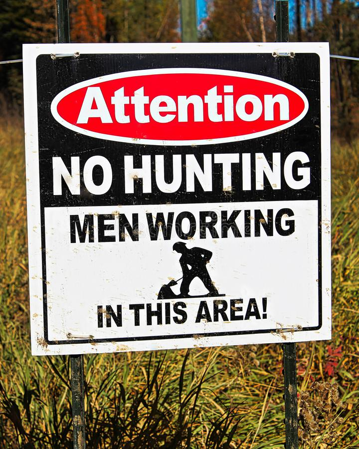 An attention no hunting, men working sign royalty free stock photo