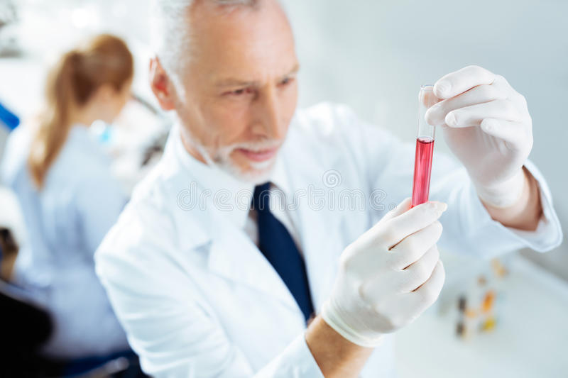 Close up of male hands that demonstrating test tube royalty free stock photo