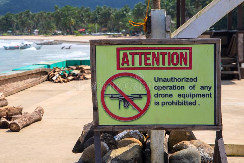 Attention sign prohibiting drone use by sea. Unauthorized operation of drone is prohibited inscription royalty free stock images