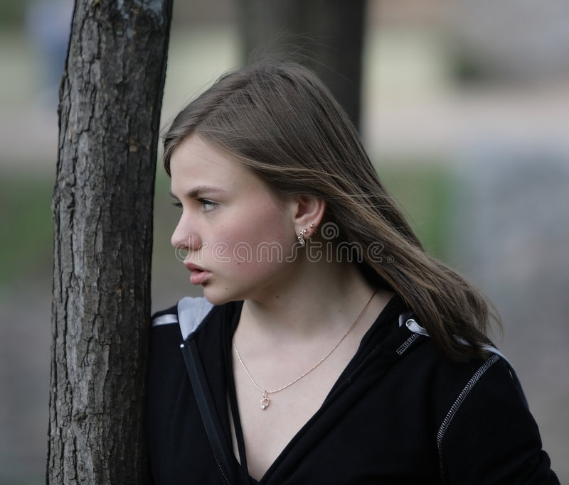 Attentive angry young woman royalty free stock image