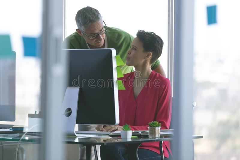 Attentive business people working at desk in creative office royalty free stock photography