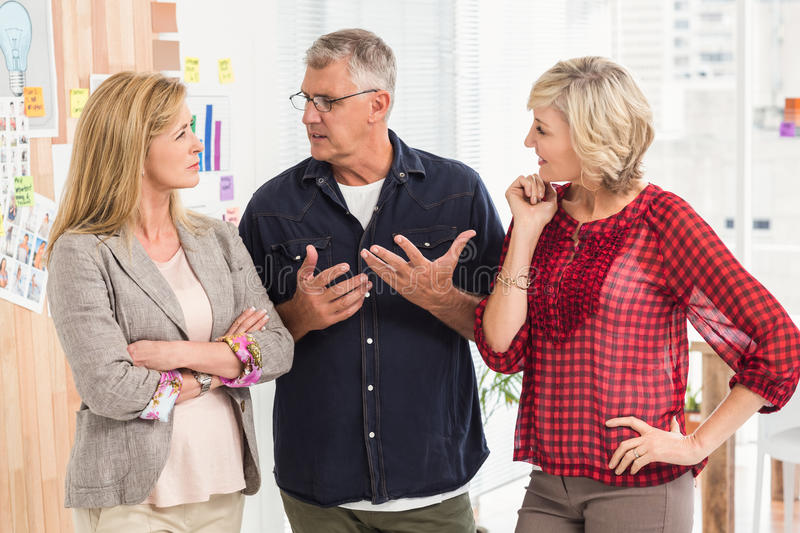 Attentive business team discussing together stock images