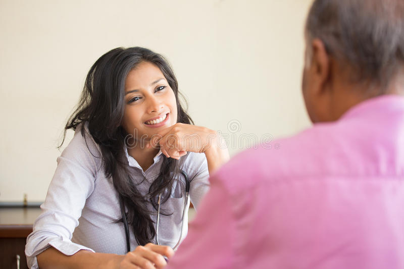Attentive healthcare professional. Closeup portrait, patient talking good news conversation to healthcare professional, indoors background stock images
