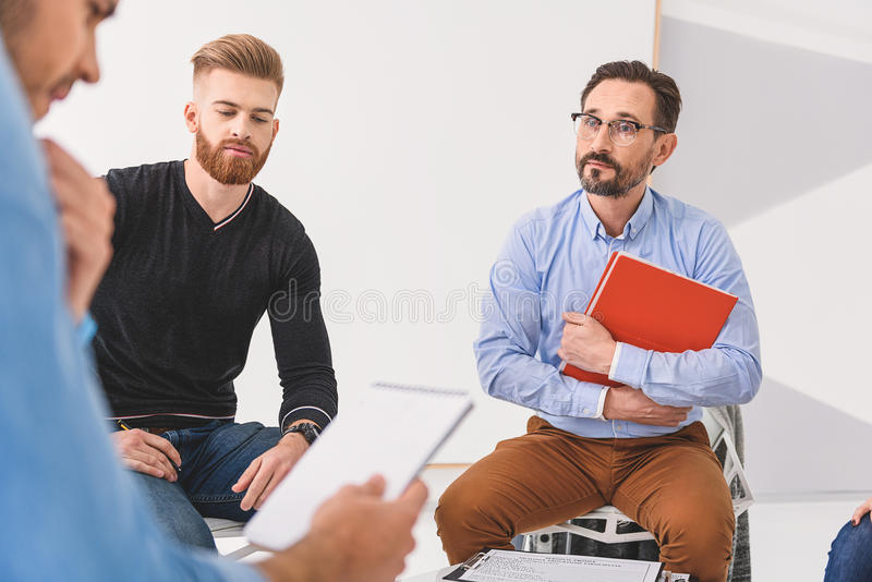 Attentive psychologist listening with interest stock photos