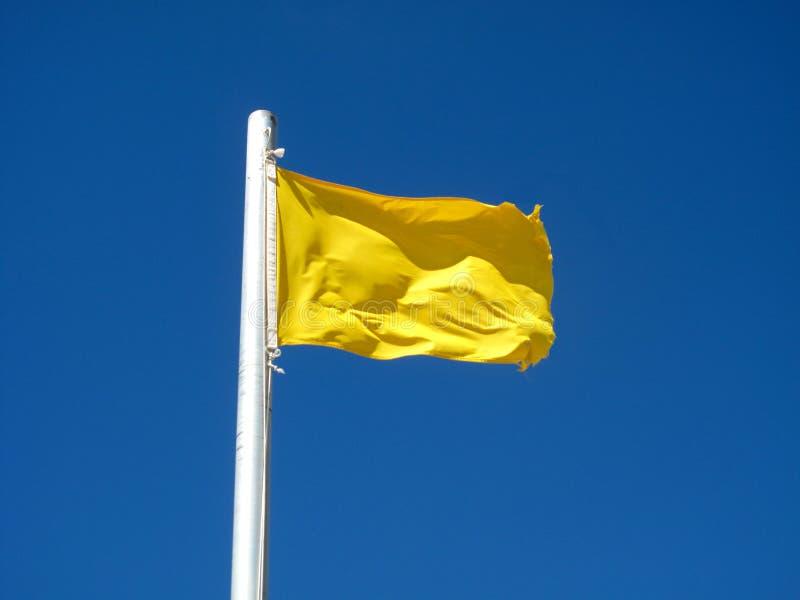 Attenzione, bandierina gialla immagini stock