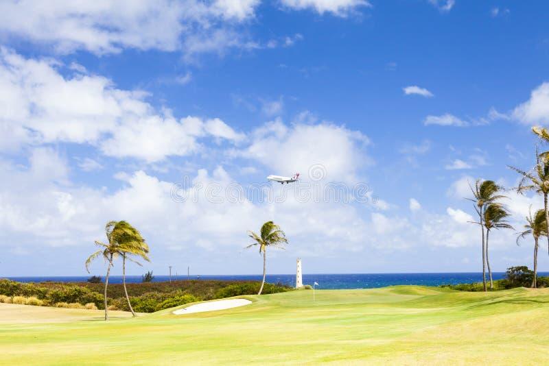 Atterraggio di Hawaiian Airlines dell'aereo dell'isola di Kawaii nel kawaii dell'Hawai con il sole fotografie stock libere da diritti