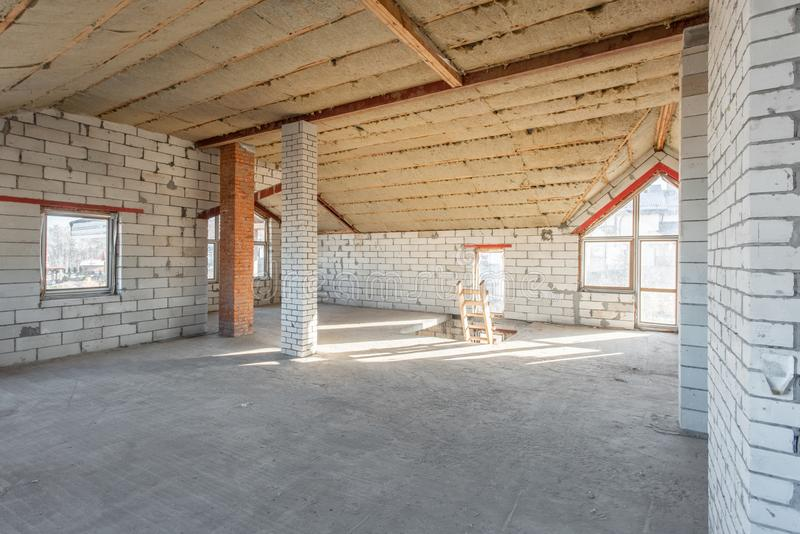 Attic floor of the house. overhaul and reconstruction. Working process of warming inside part of roof. House or. The second attic floor of the house. overhaul stock photos