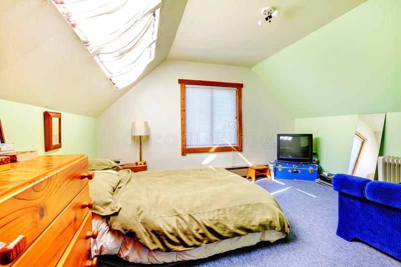 Attic large bright simple bedroom royalty free stock photos
