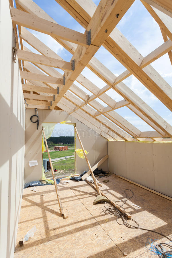 Attic room under construction with gypsum plaster boards. Roofing Construction Indoor. Wooden Roof Frame House Construction royalty free stock photography
