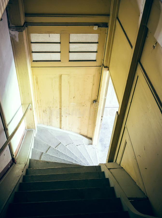 Attic staircase with sunlight stock images