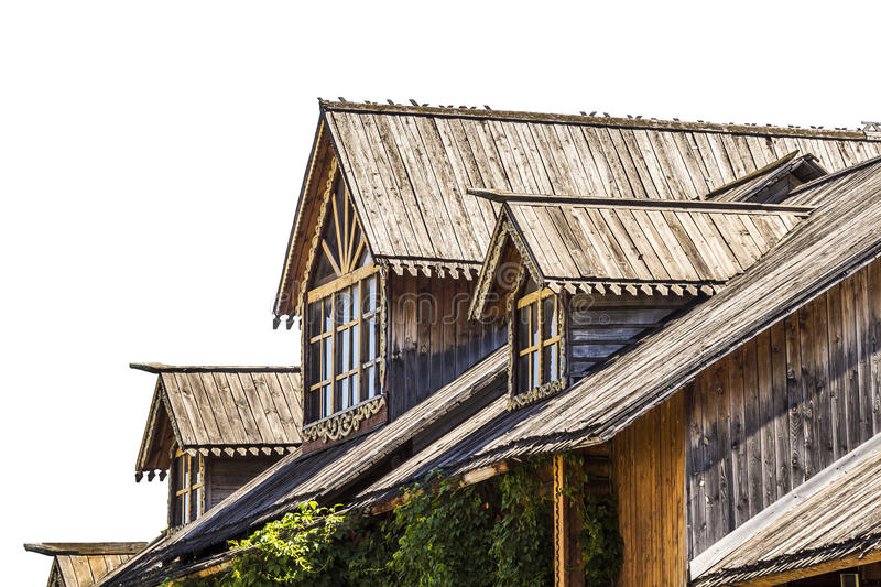 Attic window of a wooden house stock image