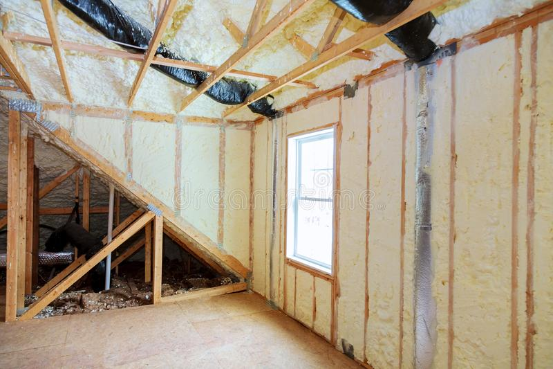 Attick loft insulation partly isolated wall royalty free stock photography