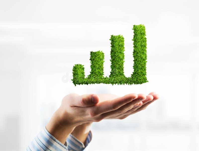 Attività bancarie ed investimento dei soldi presentato dal grafico verde Media misti fotografia stock