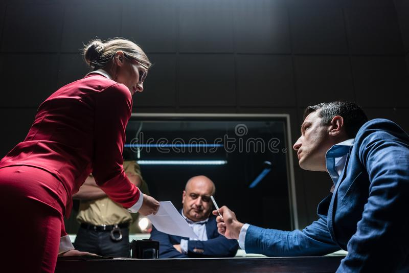 Attorney in disagreement with the prosecutor during the hearing of a suspect stock images