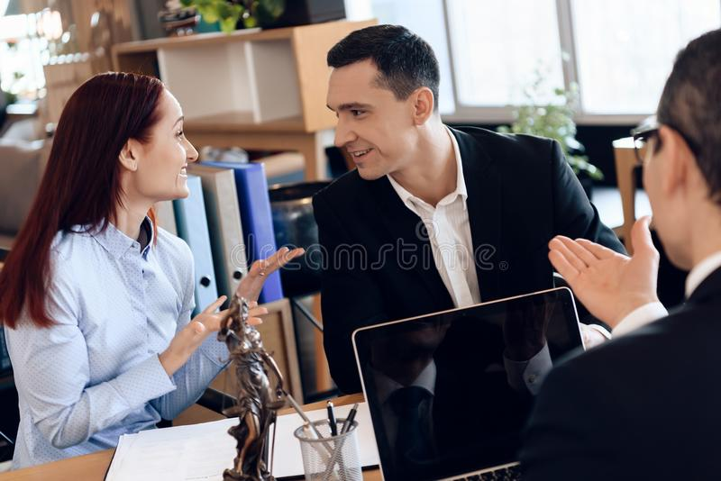 Attorney sit at office table, listening to divorcing couple discussion. royalty free stock images
