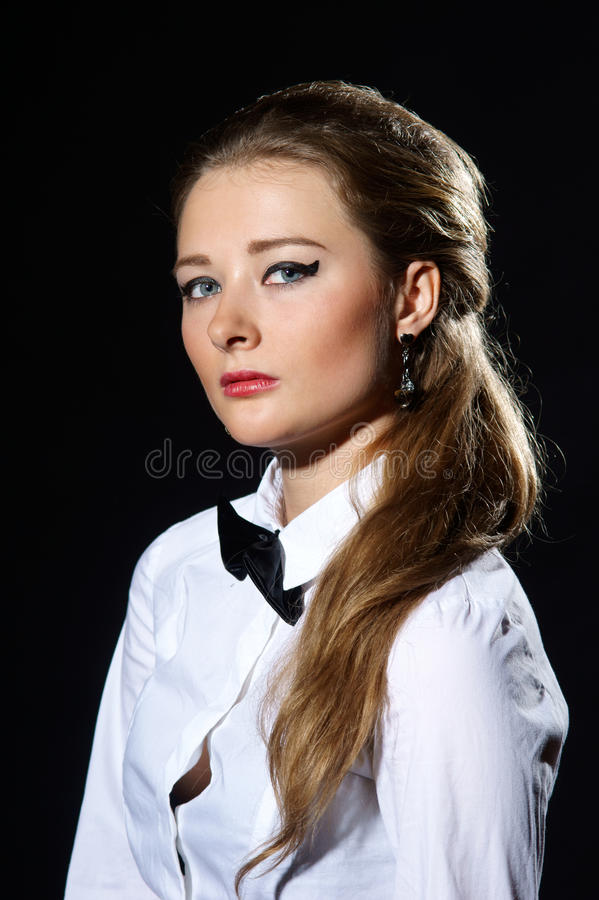 Attracive woman in white shirt and black tie royalty free stock images