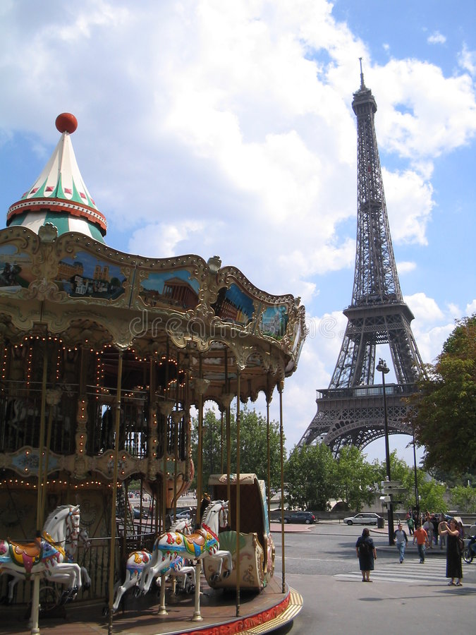 Attraction in the center of Paris. Mary-Go-Round and Eiffel Tower stock image