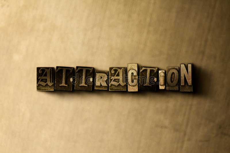 ATTRACTION - close-up of grungy vintage typeset word on metal backdrop stock photos