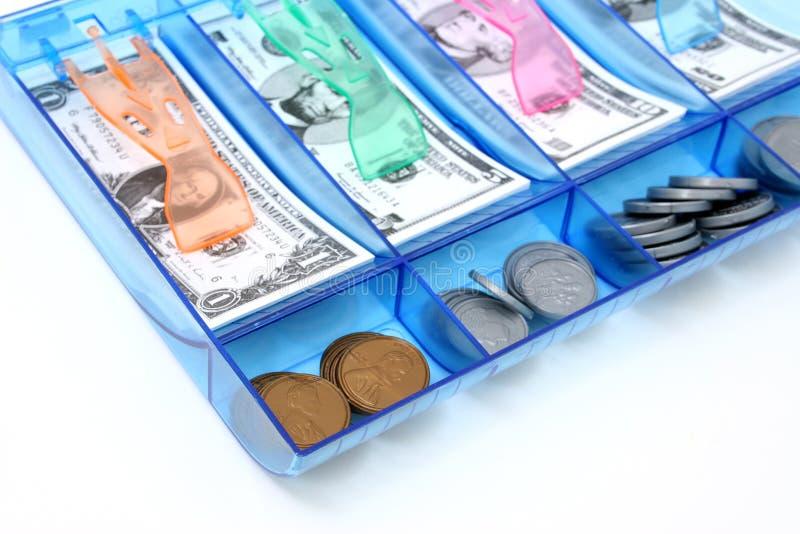 Attraction d'argent comptant du papier et de l'argent USD de jouet de pièce de monnaie photographie stock libre de droits