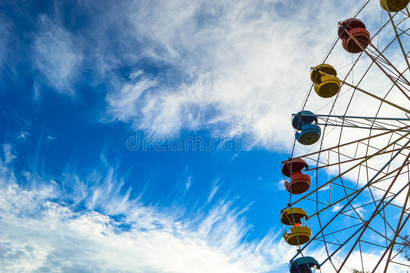 Attraction Ferris wheel in the bright blue sky. royalty free stock photo