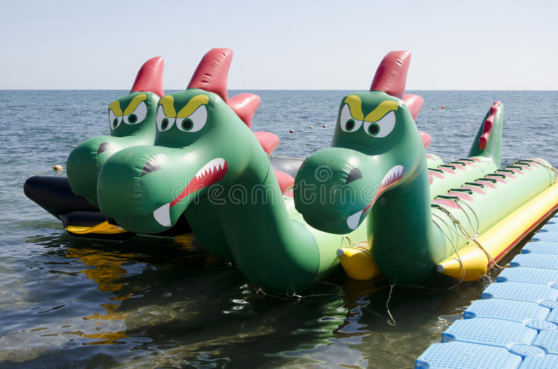 Attraction on the water in the form of a dragon. SUDAK, CRIMEA, RUSSIA - AUGUST 24: Attraction on the water in the form of a three-headed dragon on the seafront royalty free stock images