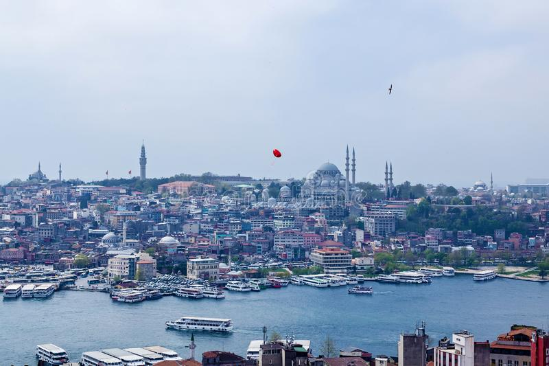 Attractions in Istanbul. A red ball in the form of a heart flies over the Cityscape with Galata Tower over the Golden Horn in Istanbul, Turkey stock photos