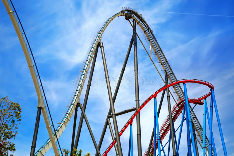 Attractions Shambhala and Dragon Khan in the theme park Port Aventura in city Salou, Catalonia, Spain. Attractions Shambhala and Dragon Khan Located in the stock images