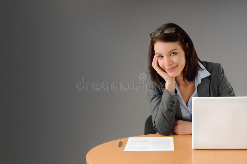 Attractiv business woman at desk stock images