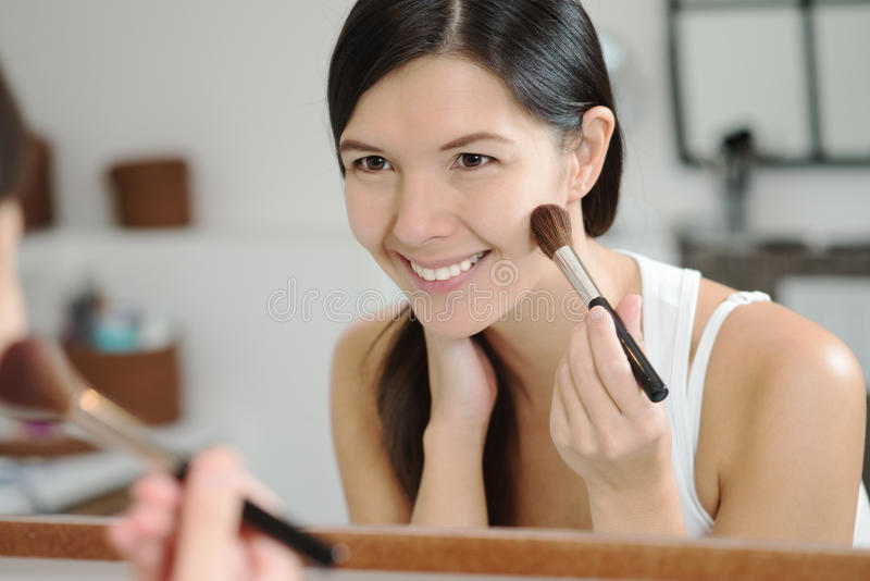 Download Attractiv Happy Woman Applying Makeup Stock Photo - Image of enhance, hairstyling: 35610432
