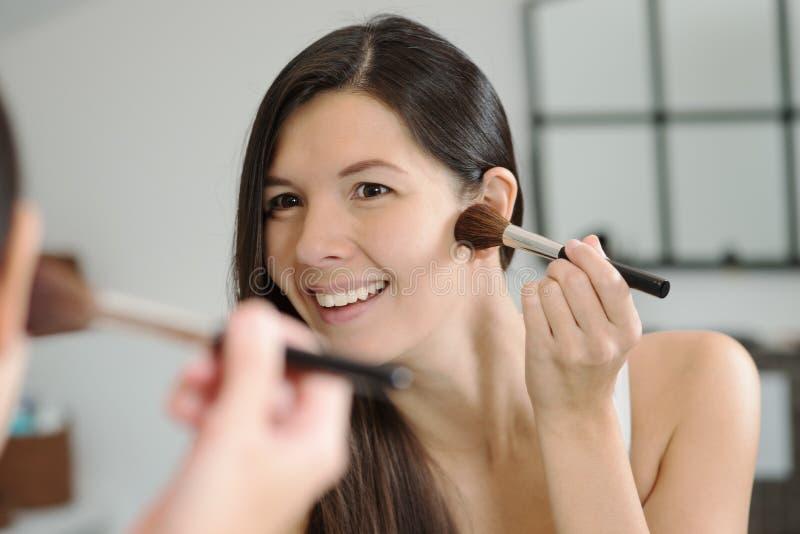 Download Attractiv Happy Woman Applying Makeup Stock Photos - Image: 35610443