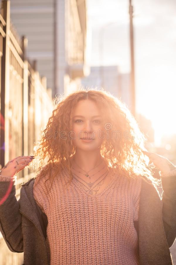 Cheerful young woman portrait city outdoors at sunset stock image