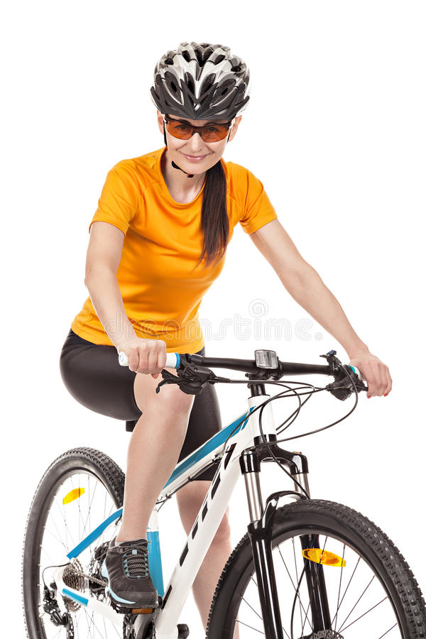 Attractive adult woman cyclist isolated on white background stock photo