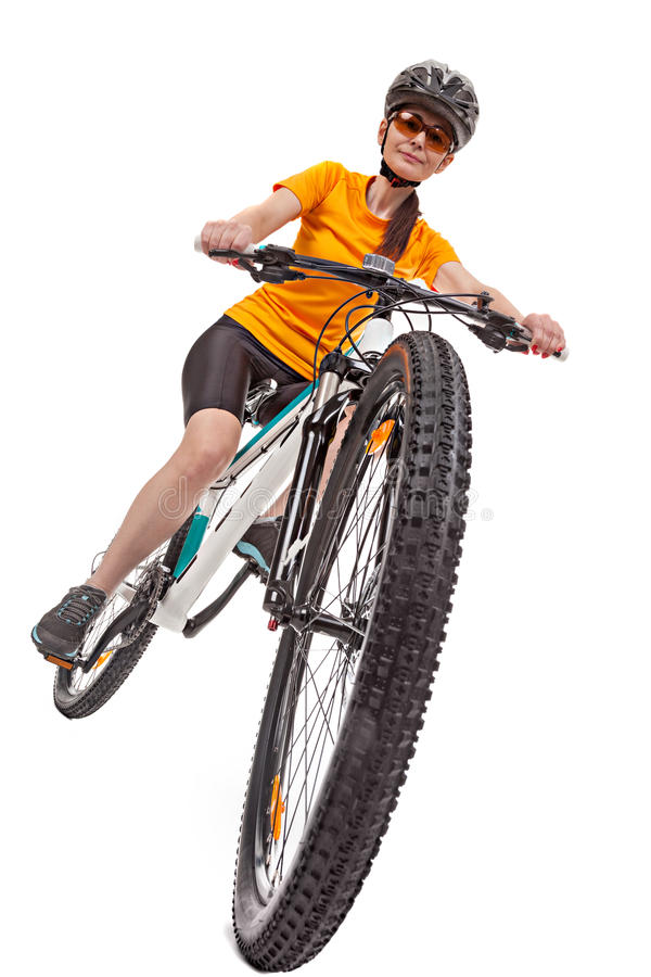 Attractive adult woman cyclist, riding a bike. stock images