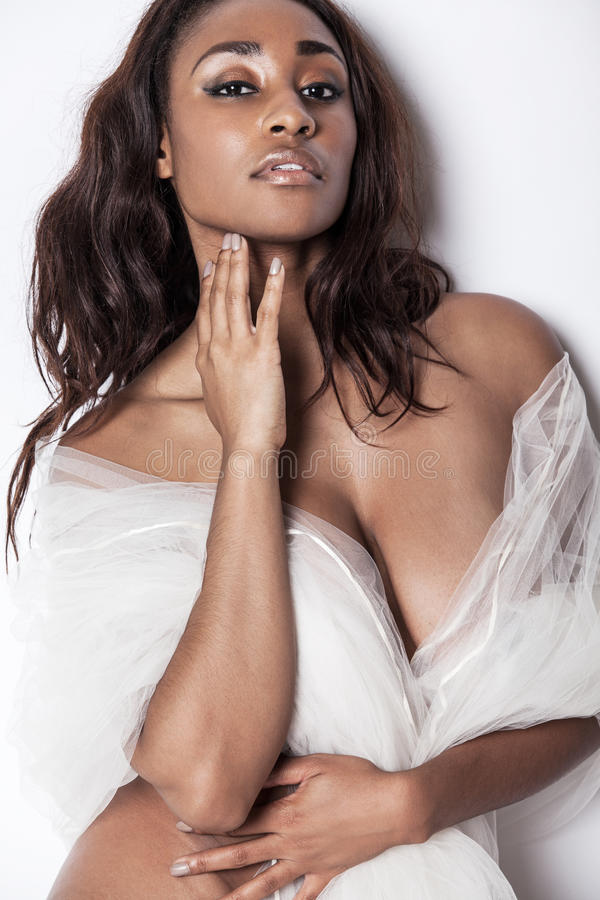 Attractive African-American model with long hair. royalty free stock photos