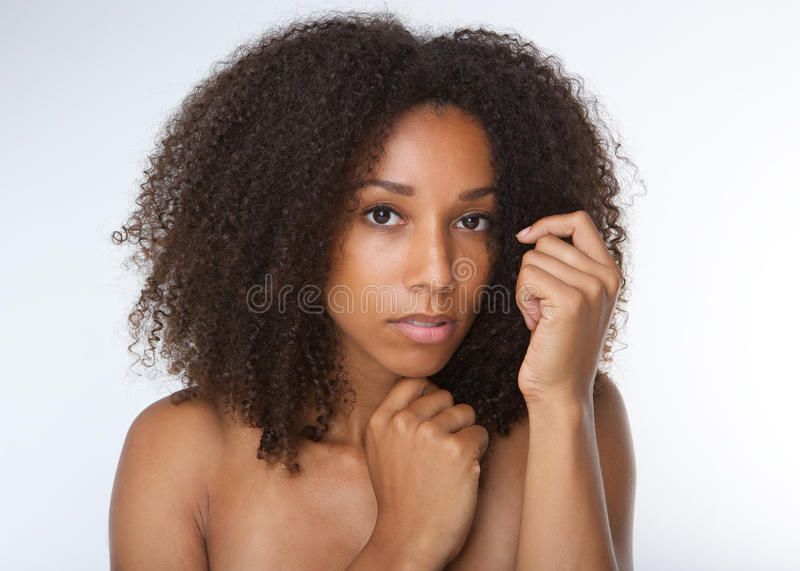 Attractive african american young woman with curly hair royalty free stock images