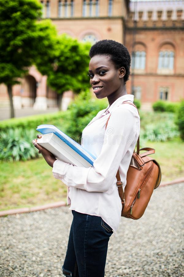 Start to study. Attractive african female college student on campus stock image