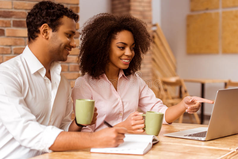 Attractive Afro-American couple working stock photography