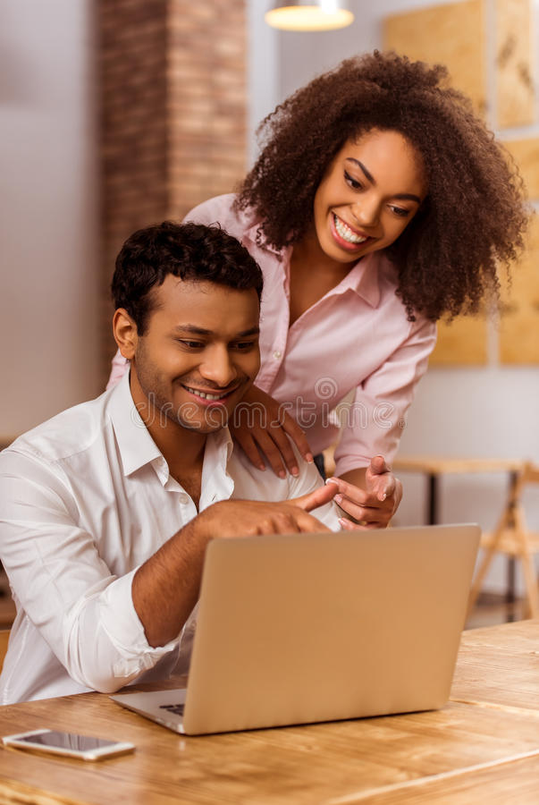 Attractive Afro-American couple working stock photo